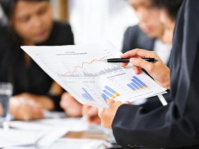 Businessman holding stats and figures